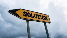 Way to a solution. Word Solution written on yellow street sign with left pointing arrow Stock Photo