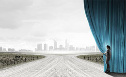 Way to something new. Businesswoman opening curtain to new roads and opportunities Stock Photo