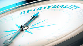 Way to Spirituality. Compass with needle pointing the word spirituality. Conceptual 3D render image with depth of field blur effect for illustration of search of Royalty Free Stock Photos