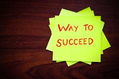 Way to succeed on yellow sticky note Stock Image