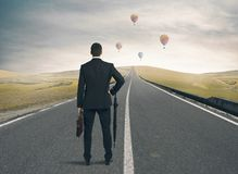 Way to success. Businessman looking the way to success Stock Images