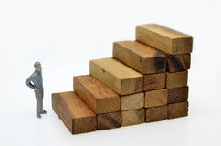 Way to success with  businessman and wood block step Royalty Free Stock Image