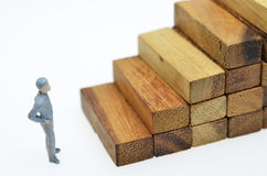 Way to success with  businessman and wood block step Stock Image