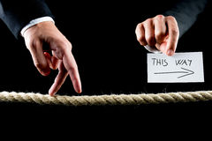 The way to success. Metaphoric image of male hand walking on frayed rope towards success Royalty Free Stock Image