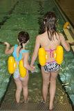 On the way to swimming pool. Sisters on a trap to swimming pool Stock Photography