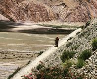 The way to the temple. Monk walking to the monastry in Zanskar Valley royalty free stock photo