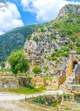The way to the theater. Two landmarks theater and tombs from different epochs are neighbor on the foot of the hill in Myra, Turkey Royalty Free Stock Photo