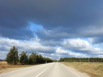 Road and beautiful cloudy sky, Lithuania Royalty Free Stock Image