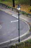 This Way or That Way. Streetlamp signpost pointing to 'this way' or 'that way'. Concept of lost or confused Stock Images