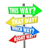 This Way That Which is Right Path Choice Arrow Signs Opportunity. This Way, That Way, Which Way, Right Way? words in a question on arrow road signs showing many Royalty Free Stock Photography