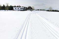 Way, winter and cottage. A Cottage on mountains in winter Royalty Free Stock Photography