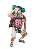 Way-worn hiker. With backpack on white background Stock Image