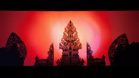 Wayang Kulit puppets. Black shadow silhouette of traditional Balinese temple. stock photo