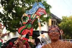 Wayang Kulit sellers on the streets, while exhibiting their selling products in Tegal / Central Java, Indonesia, stock images