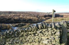 Waymarker and dry stone wall on moorland. Above Blanchland, Northumberland Stock Images