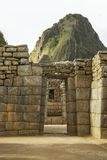 Wayna Picchu behind ruins of doors inside Machu Picchu Stock Images