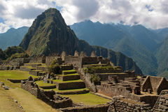 Wayna Picchu framed in ruins. Three Doorway group framing mountain Wayna Picchu in Machu Picchu Stock Photo