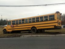 Wayne, New Jersey, United States - March 14, 2019: School bus misses turn and drives off the road. The bus needed to be towed stock images