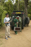 Wayne Pacelle CEO of Humane Society of United States checking stun gun used in rescue work of animal workers in Tsavo National Par Royalty Free Stock Photos