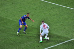 Wayne Rooney για να κτυπήσει έναν αντίπαλο Στοκ φωτογραφίες με δικαίωμα ελεύθερης χρήσης