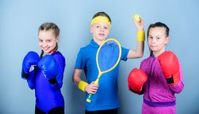Ways to help kids find sport they enjoy. Friends ready for sport training. Sporty siblings. Child might excel completely stock image