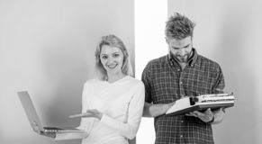 Ways to sell your old stuff for most money. Woman with modern laptop and man with old retro typewriter. Why do you keep. Ways to sell your old stuff for most royalty free stock image