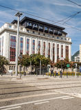 Ways the tram from the French city of grenoble. With people walking in the background is a building on a sunny day. It is an image in portrait taken in Royalty Free Stock Photography