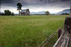Ways Of The West. Montana Farm with mountains in the background Royalty Free Stock Images