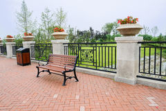 Wayside bench before balsutrade decorated with flowers Royalty Free Stock Images