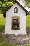 Wayside chapel built on a stone Stock Photography