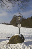 Wayside cross. A wayside cross in winter surrounding stock photography