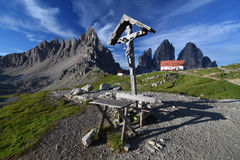 Wayside cross in Tre Cime di Lavaredo National Park royalty free stock photography