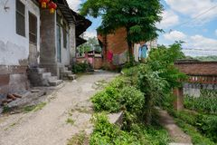 Wayside dilapidated houses in sunny summer,China Stock Photos