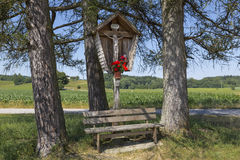 Wayside shrine and bench Stock Image