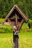 Wayside Shrine in Mountain - Trentino Italy. Typical wooden wayside shrine with jesus on cross in Italian alps. Trentino Alto Adige, Italy stock photos
