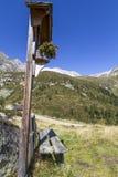 Wayside shrine in the north italian alps Stock Image