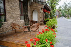 Wayside tables and chairs before Chinese traditional buildings Stock Photos