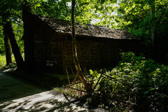 Wayside thatched hut in sunny summer afternoon Royalty Free Stock Images