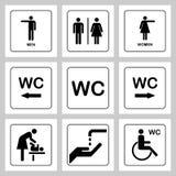 WC/洗手间门被设置的板材象 男人和妇女休息室的WC标志 免版税库存图片