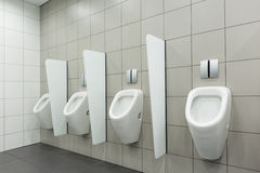 WC for men. Clean public men toilet room, wc royalty free stock photography