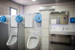 WC for men. Clean public men toilet room, wc stock photo