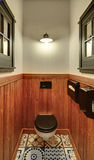 WC in mexican restaurant. Restroom with partially wooden walls in a mexican restaurant. On the sides there are decorative windows. On the back wall there is a stock images