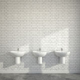 WC room with wash basins at wall of bricks Royalty Free Stock Images