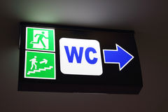 WC sign with arrow Royalty Free Stock Image