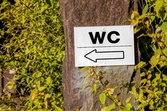 WC Sign in the forest Royalty Free Stock Image