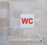A WC sign in the park Stock Photo