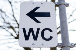 WC sign in park Stock Photography