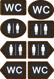 WC signs. In different shapes with a wood frame. Icons and text Stock Photography