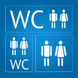 WC signs set. White WC signs set with blue background Stock Photography