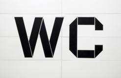 WC toilet black white tile Stock Images